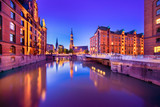 The Warehouse District (German: Speicherstadt) in Hamburg, Germany at night.  The largest warehouse district in the world is located in the port of Hamburg within the HafenCity quarter.