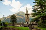 Mountain church under blue cloudy sky