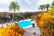 Leinwanddruck Bild - Beatiful exterior of the Jameos del Agua with pool and colorful trees, Lanzarote, Canary Islands, Spain