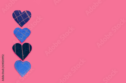 Hand made Jeans hearts on a pink background. Flat lay, top view, minimal style, copy space for text. Symbol of love, for Valentine's day greeting card or social media post - 240264952