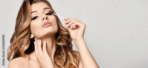 Leinwanddruck Bild Beauty woman hold black mascara eyelashes  makeup brush clear healthy face portrait