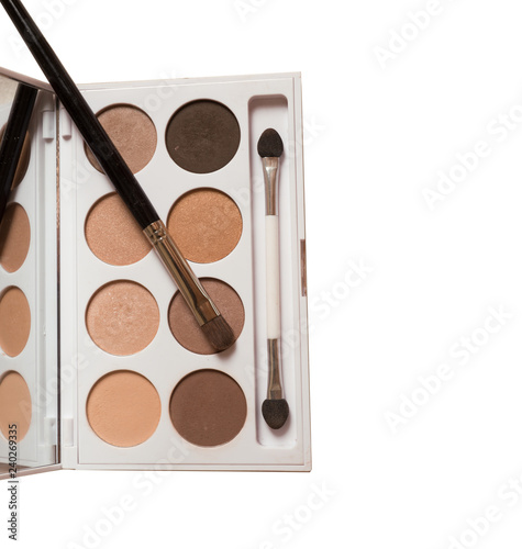 Makeup brush and beige eye shadows palette