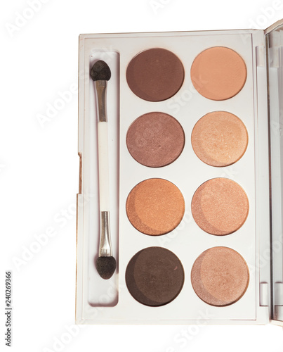 Makeup brush and nude eye shadows palette