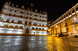 Night view of the building designed by Gaudi in the city of Leon, Botines. You can see a Gaudi sculpture observing the building. Leon, Spain. Winter of 2018.