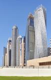 Dubai modern skyscrapers against the blue sky, United Arab Emirates.