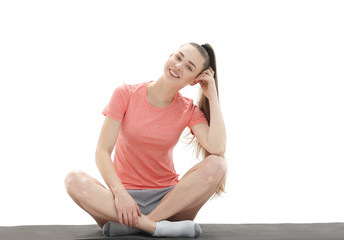 fitness, sport, people and healthy lifestyle concept - woman making yoga meditation in lotus pose on mat