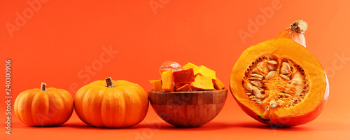Pumpkin and pumpkin slices Autumn Healthy Food Nutrition Seasonal Vegetable Concept - 240300906