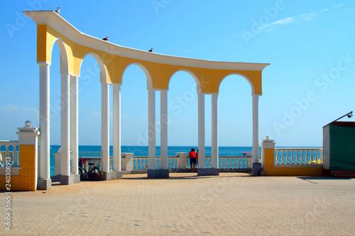 portico with columns on the sea promenade