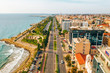 Aerial view of Molos Promenade park on coast of Limassol city centre in Cyprus. Bird's eye view of the jetty, beachfront walk path and palm trees by the sea. - 240310975