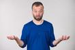 Leinwanddruck Bild - Confused adult man seeking for solution