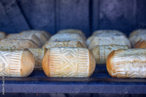 The polisch cheese specialty oscypek is cured and smoked in a wood hut for the final stage of the processing.