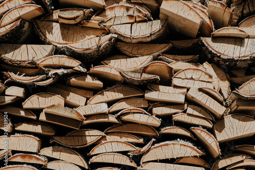 woodpile of birch wood. Texture of logs to light a fire