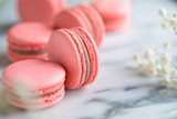 Coral cakes macarons or macaroons on white marble. - 240407168