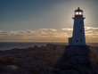 Peggy's Cove lighthouse at sunset in the winter, tourist, cold, Atlantic Ocean, seaside