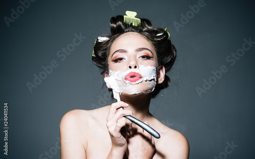 4ef82fc07b pin up woman with trendy makeup. retro woman shaving with foam and razor  blade.