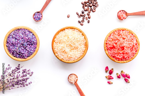 Aromas of bath salt. Coffee, rose, lavender near bowls with colorful bath salt on white background top view