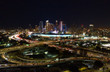 Urban aerial view of the downtown Los Angeles convention center, city skyline and freeway traffic at night