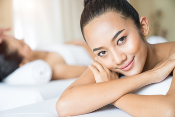Young beautiful tan skin woman smiling in the massage spa © virojt
