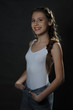 Beautiful teenager girl. Studio portrait. Dark background