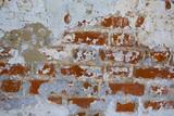 Old shabby brick wall of the monastery close-up.