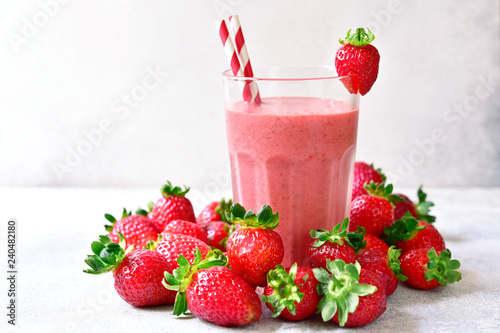 Strawberry banana smoothie in a tall glass. - 240482180