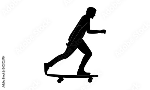 silhouette image of a man riding a skateboard looking sideways.