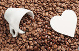 coffee beans roasted as a background with space for text as a heart