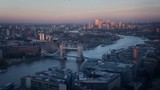 time lapse London skyline with illuminated Tower bridge and Canary Wharf in sunset time, UK - 240522368