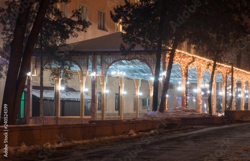obraz lub plakat street restaurant night area with illuminations