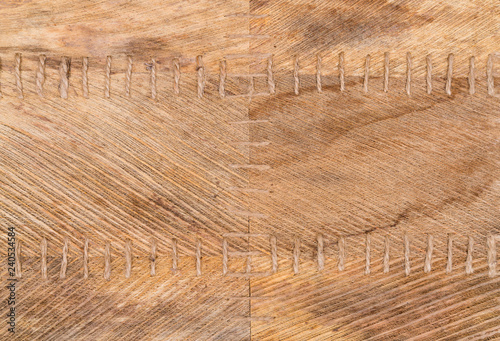 Light brown dried palm leaves as a background.