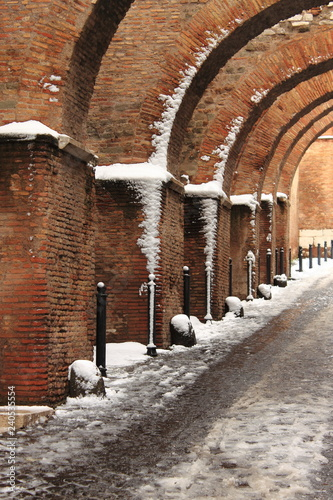 Romanic style archway in wintertime in Rome, Italy
