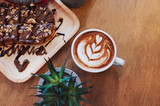 Hot Coffee on wooden table with chocolat on bread