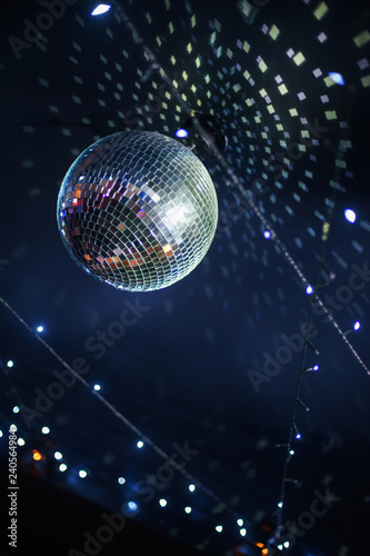 Bright mirror ball disco ball under the ceiling.  - 240564984