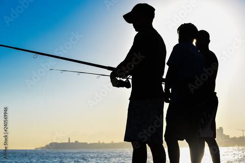 obraz PCV Fishermen at the Malecon waterfront in Havana, Cuba