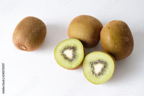 Ripe whole kiwi fruit  isolated on white background