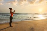 Woman doing yoga on beach © Dmitry Rukhlenko