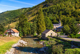 View of the village of Ustou in summer, Couserans-Pyrenees, Ustou Valley, Ariège, Occitanie, France.