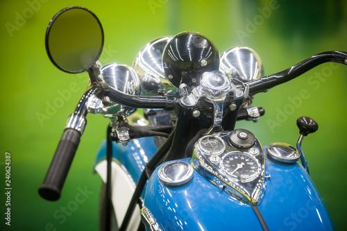 Vintage motorcycle handlebars and speedometer