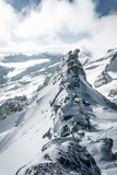 Aerial landscape view of the beautiful snow covered mountains National park Alps in Rakousko,  Picture taken in the mountain Zillertal Arena Tirol, Austria Europe