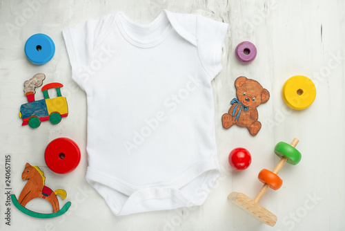 11f8a38dc4ca Layout Flat Lay white baby shirt bodysuit on
