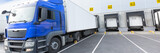 Loading dock of large warehouse with blue cabin truck under loading - 240657913