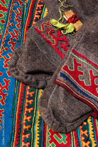 obraz lub plakat Elements of traditional winter cloth and rich decorated fabrics of nomadic tribe of Far North, Polar Circle of Russia
