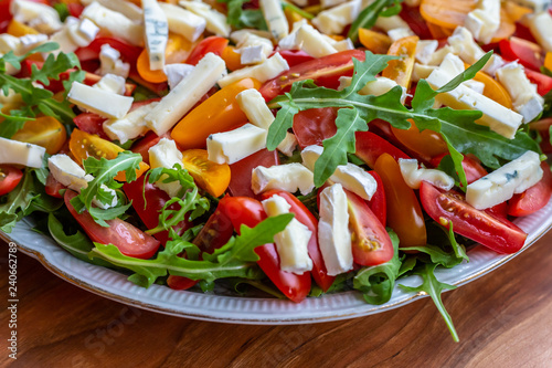 Salad with tomatoes, blue cheese, arugula and sunflower seeds