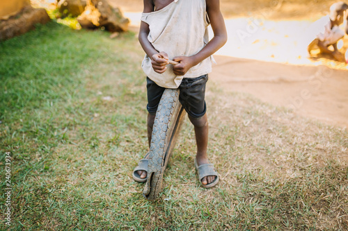 child with a tire in Uganda, Africa