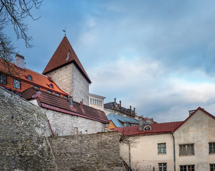 Fragment of the Old Town. Old Town is a medieval district of Tallinn, Estonia. Tiled roofs and stone walls are bright signs of antiquity. Old Town is a popular place among tourists
