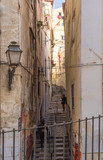 Fototapeta Na drzwi - Lisbon - Portugal. a narrow stone staircase leads into the ancient Alfama district © gpriccardi