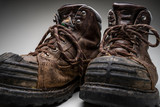 Studio shot of steel toed hiking boots on a grey background - 240694142