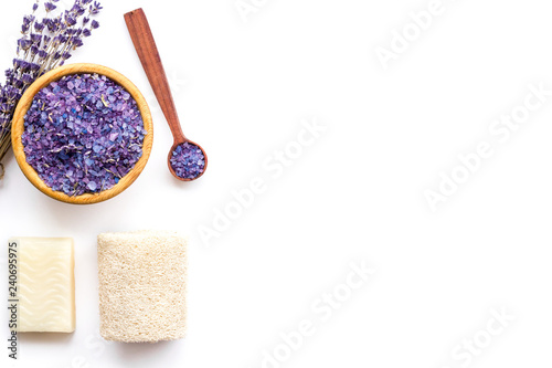 Spa set with lavender spa salt. Purple spa salt near dry lavender branches and washcloth on white background top view space for text