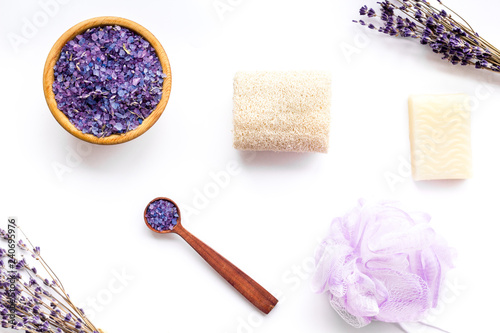 Spa set with lavender spa salt. Purple spa salt near dry lavender branches and washcloth on white background top view