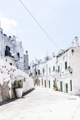 Street view of white houses in old Italian village